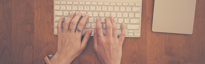 Person typing mac keyboard - The Science Behind Writing Effective Headlines