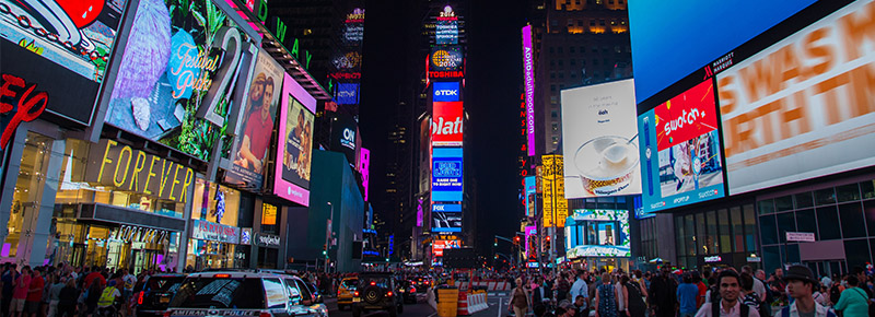 New York Times Square at Night. The benefits of digital marketing include SEO and social media.