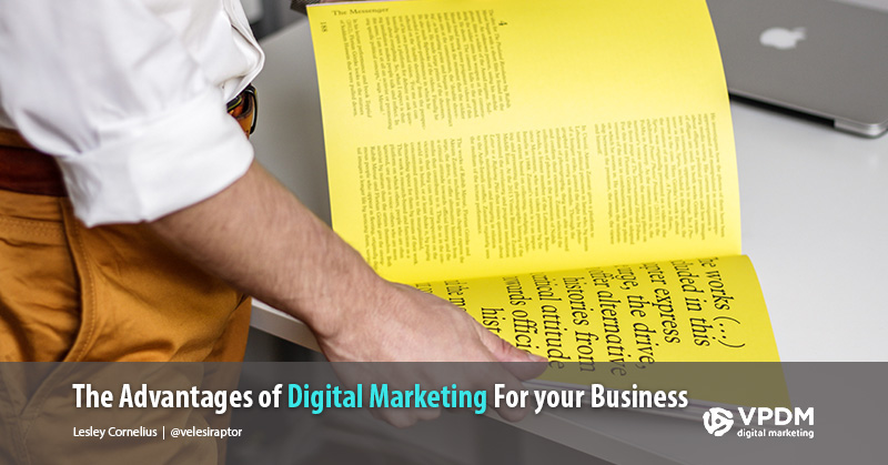 Man looking at magazine. Why digital marketing has more benefits than traditional marketing.