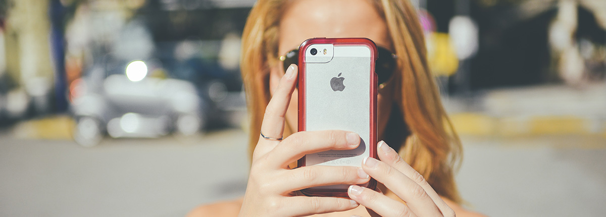 Female millennial using Snapchat on a smartphone. How the Snapchat Influencer Network Will Boost Your Business