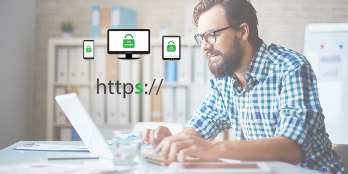 Man typing on a laptop in a startup type office. What you need to know to move your Wordpress website to HTTPS. VPDM Digital Marketing, Website and SEO Agency Niagara, Hamilton, Toronto.