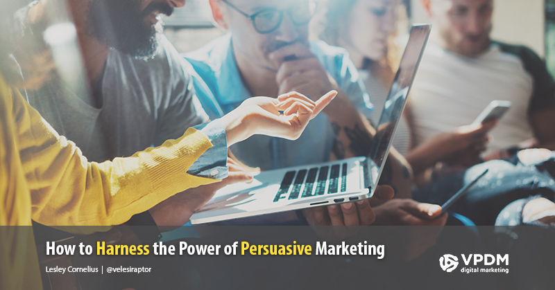Group of millennials around a laptop and smartphones. Persuasive marketing. Persuasive techniques in advertising.