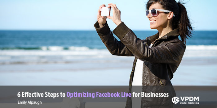 Woman on beach with leather jacket smiling and using cell phone to take video. How to optimize Facebook live for business.