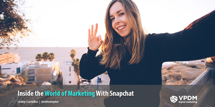 Woman with long brown hair and smiling, taking Snapchat selfie on the beach using Snapchat Geofilters. The Importance of Filters for Your Snapchat Marketing Strategy. Social media marketing company Niagara, St. Catharines, Hamilton.