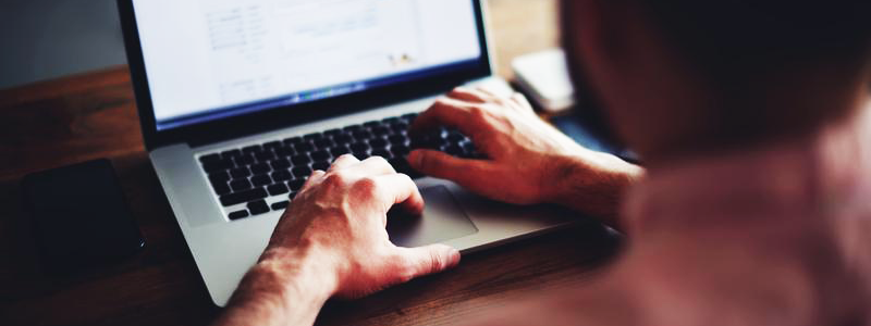 Man searching terms on laptop