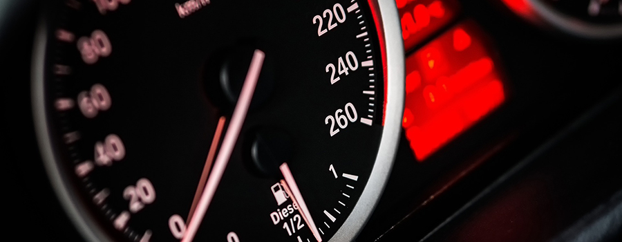 Car speedometer in black and red. Car dealership marketing ideas. social media marketing for car salesman marketing ideas for small car dealerships.